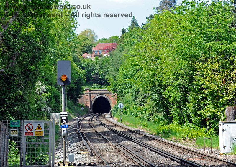 """Roughly the same view on 31.05.2021.  The signal has been converted to LED operation, and the end of the platform has been blocked by a gate and a """"no-walk"""" surface.  There are the now obligatory group of warning signs which just state the obvious, plus a more useful notice from """"The Samaritans"""". 18183"""