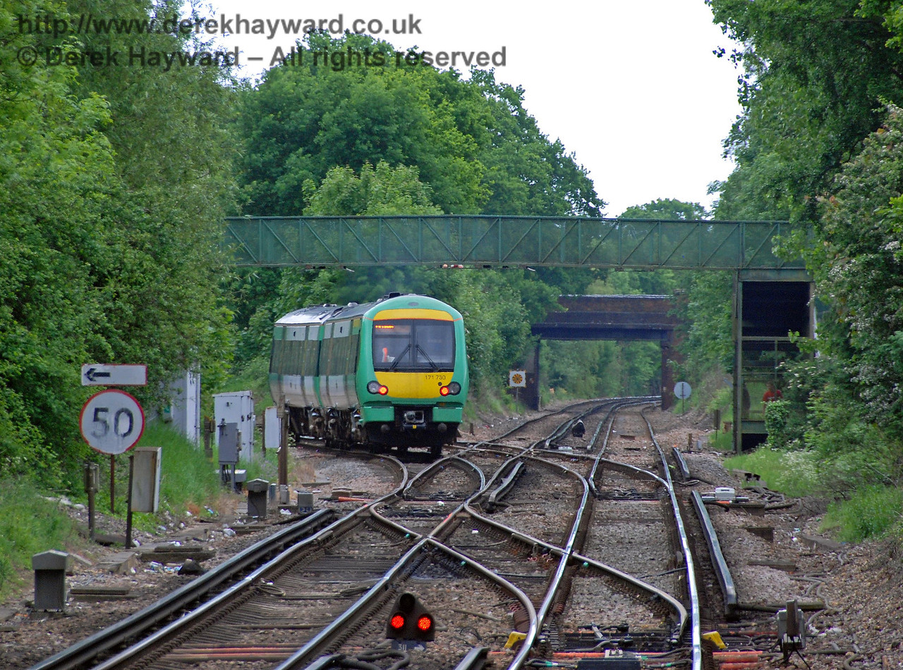 Looking south to Hurst Green Junction with a long lens. Turbostar 171730 turns left on to the non-electified line to Uckfield, whilst the line to East Grinstead runs directly south away from the camera. 18.05.2008