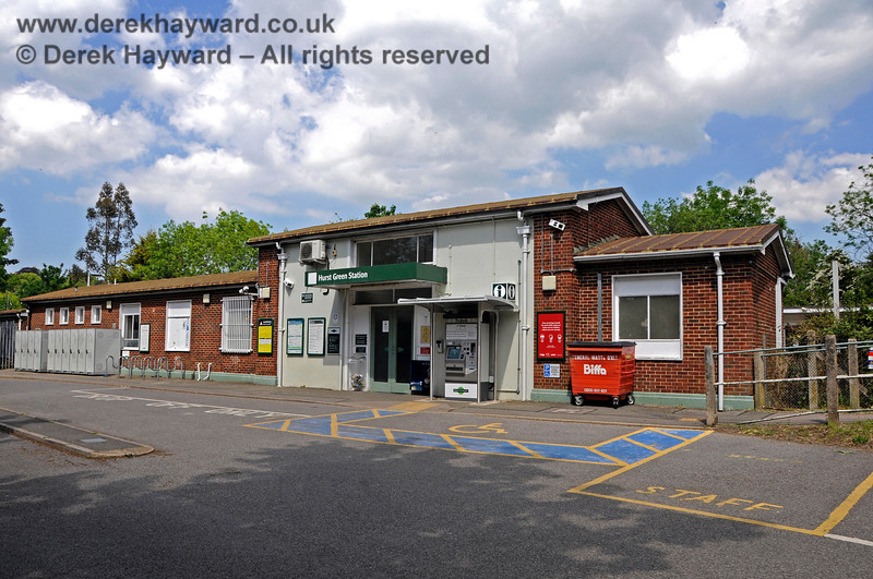 Hurst Green Station building and forecourt pictured on 31.05.2021.  The cycle lockers which stand at the northern end of the forecourt have been supplemented with some cycle racks and a ticket machine is in situ. 20908