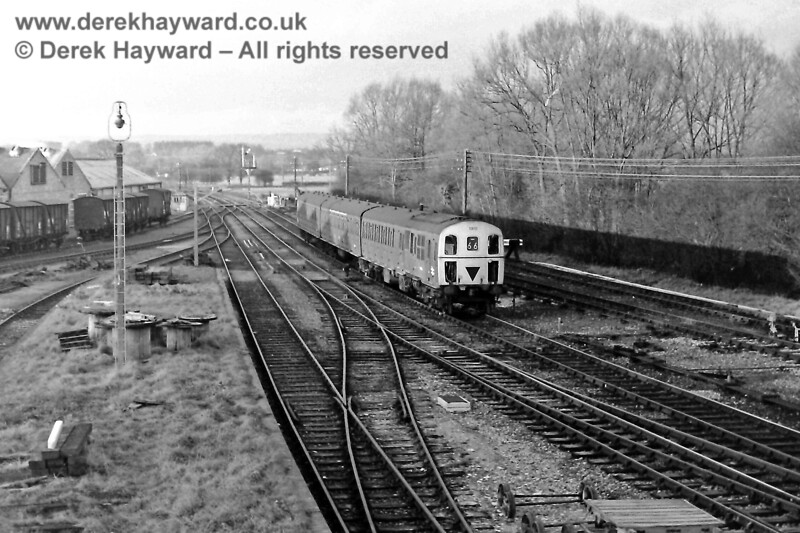 1310 arrives at Lingfield with the 16:09 service from Victoria on Saturday 7 February 1970, passing the large number of sidings then provided.  In the foreground the goods dock is looking a little overgrown, and to the left vans provided for the banana traffic await their next duty.  I am grateful to Eric Kemp for allowing his images to be used in this gallery, and he retains all rights to this image.