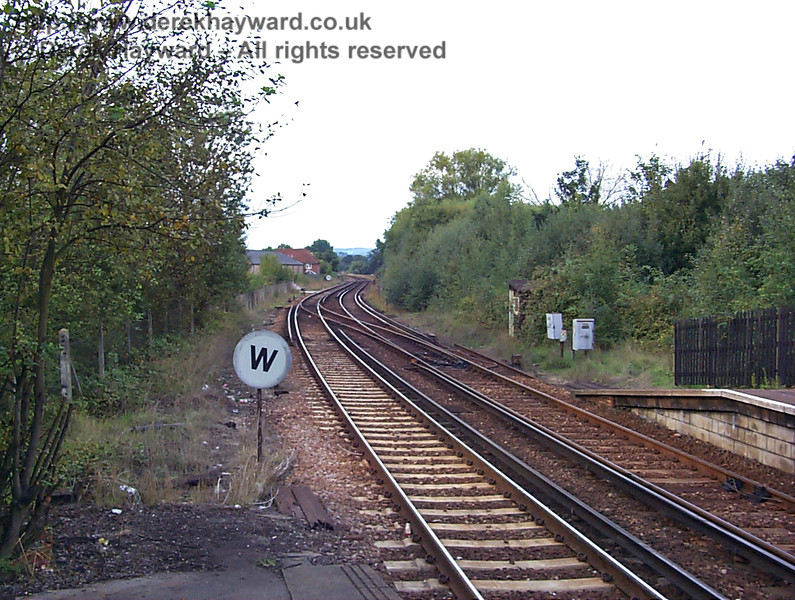 This old low resolution view north from the northbound platform in 1998 shows a rather dilapidated Whistle sign on the site of the former signal box. A line ran behind the signal box into a short bay platform at the northern end of the northbound platform. 27.09.1998