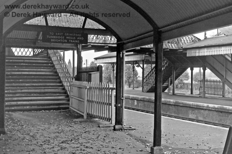 Lingfield station on Saturday 5 October 1968.  Eric Kemp is standing under the covered way that led from the Up platform towards the racecourse (behind the camera) and looking towards the stairs of the Race Day footbridge which then stood at the southern end of the station.  This footbridge was subsequently removed for use by the Bluebell Railway at Sheffield Park station.  Note the sign indicating the then diverse southbound service which served East Grinstead, Tunbridge Wells and Brighton.  So much has been lost.  Eric Kemp retains all rights to this image.