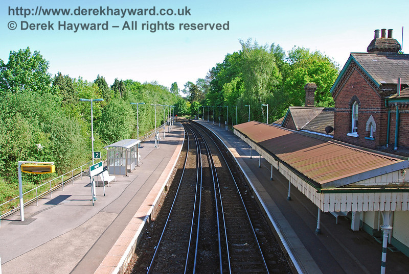 A view from the footbridge at Lingfield Station looking south. The southbound platform on the left became an island platform in 1894 to allow additional trains to serve Lingfield Race Course, which was opened in 1890. The station has subsequently reverted to a simple two track layout but, unlike other stations in the area, has retained it's traditional canopy on the northbound platform. If you are waiting for a southbound train you have to make do with a bus shelter. 11.05.2008