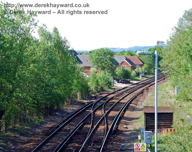 Looking north from Lingfield Station footbridge with a longer lens. A housing estate can be seen on the west side of the line and occupies the site of huge banana ripening sheds that received regular railway goods traffic from Avonmouth Docks until 1 October 1971. 11.05.2008