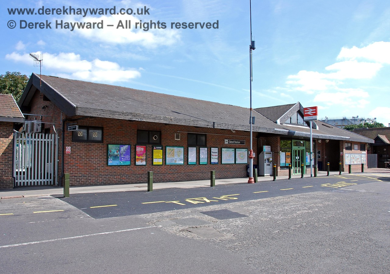 Looking south at the main entrance with the taxi rank vacant. A gate on the left provides access to the northbound platform when the ticket office is closed. 14.09.2008
