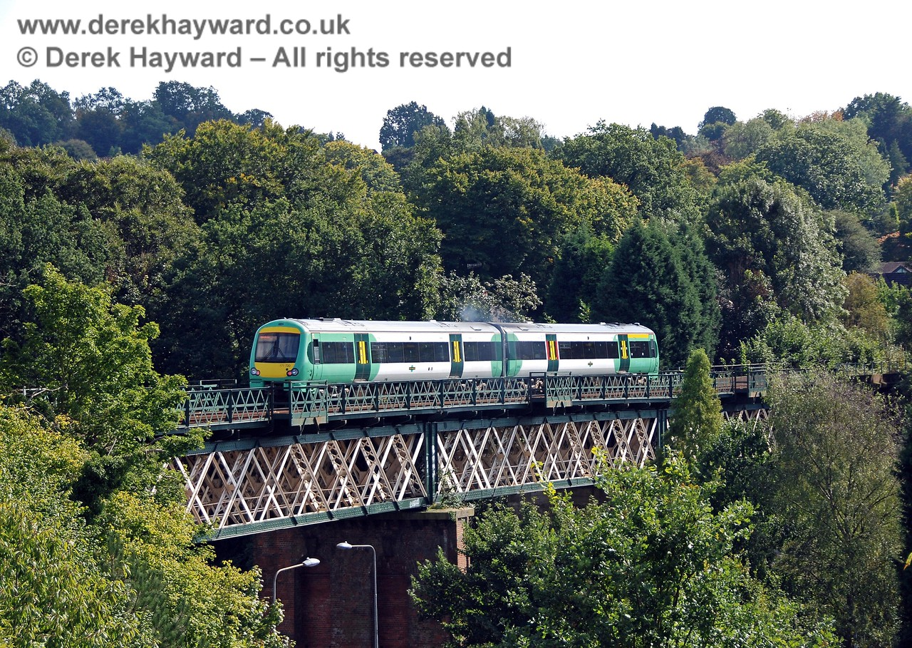 A slightly wider view of Turbostar 171730 crossing Oxted Viaduct with an Uckfield line service. 14.09.2008