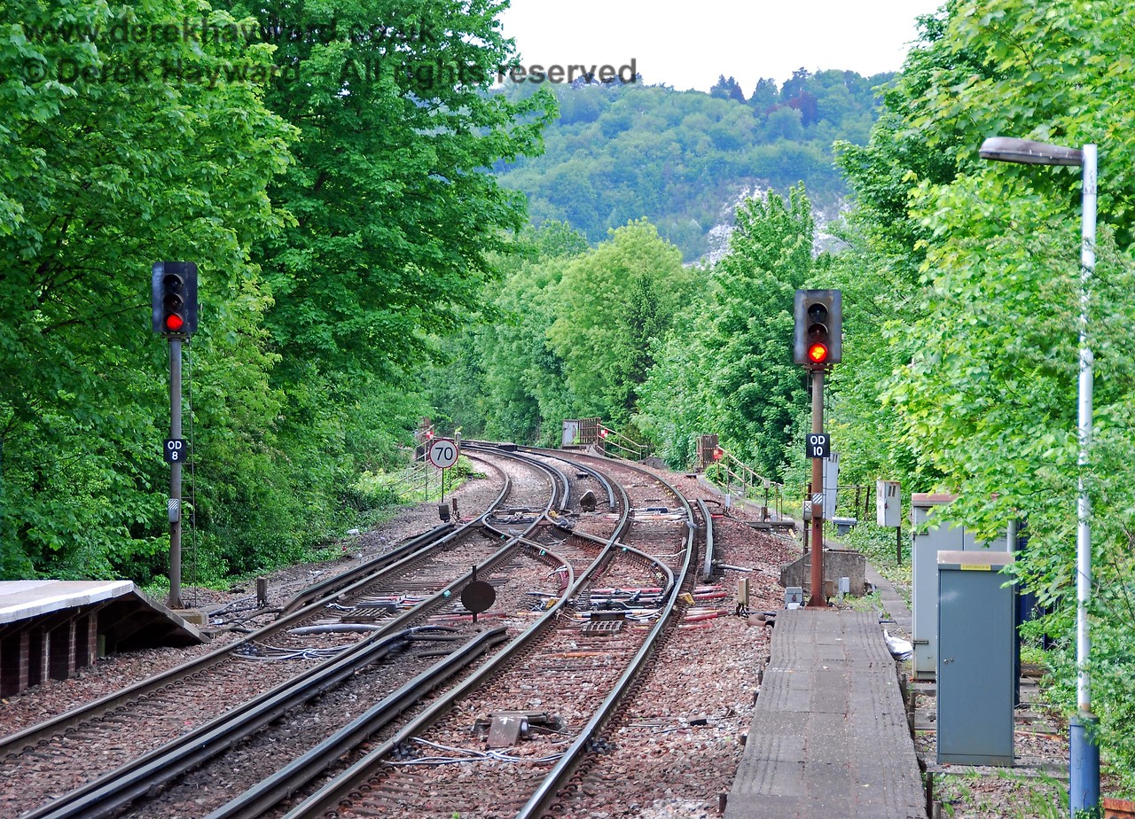 Looking north from Oxted Station. The huge chalk ridge of the North Downs can be seen in the distance and the railway tunnels through it to emerge south of Woldingham. The platforms are staggered, hence the need for the path to signal OD10. 18.05.2008