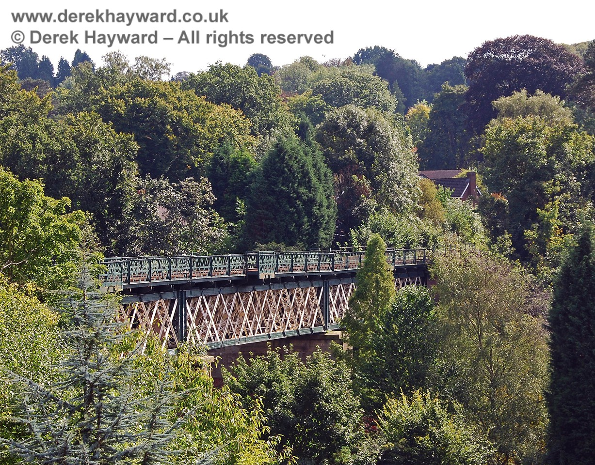 A view of the top of Oxted viaduct, looking south. The viaduct is a tall structure and stands above most of the adjacent trees. 14.09.2008