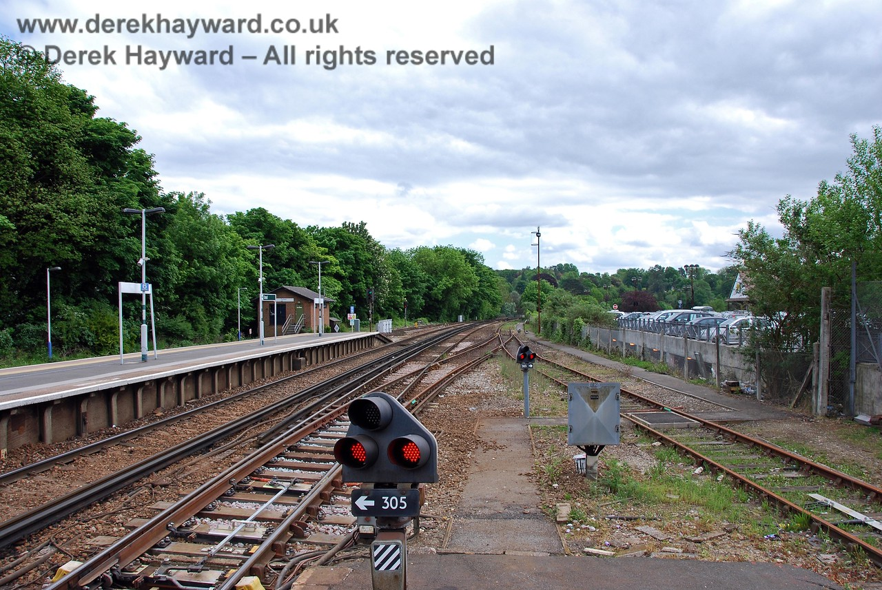 A view south from the end of the northbound platform showing the headshunt on the right.  In previous times this headshunt also gave access to additional sidings in the goods yard, an area now occupied by the cars on the right. 18.05.2008
