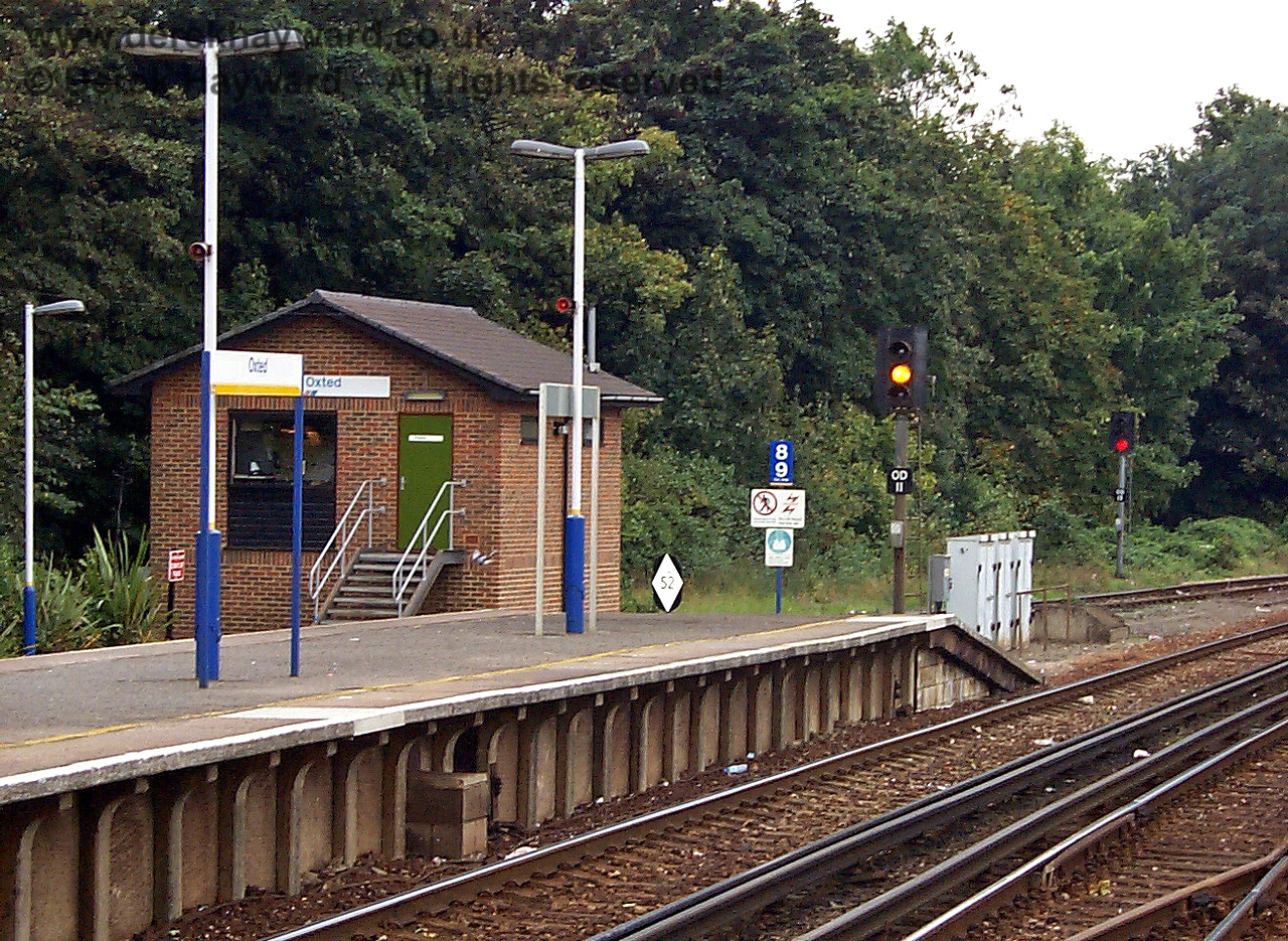 This old view looking across at the signal box in 1998 catches the Connex colour scheme on the signs and lamps, together with the two signals which control southbound departures. The original signal box at the station (of more traditional style) stood at the end of the soundbound platform. 09.10.1998