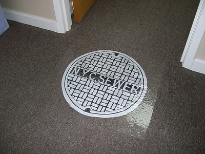 Manhole Cover/Entrance to Lair