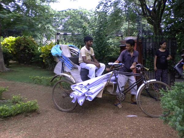 Cycle rickshaws transported everything.