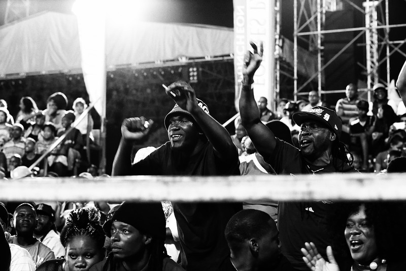 The crowd reacts to the spectacle center stage