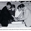 The McNemars and the Sizers cut the cake at a 1984 banquet celebrating ten years of coed education. (Photo from 1984 Andover Bulletin)