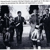 Massachusetts Governor Michael Dukakis is piped up to the steps of Sam Phil durimg PA's Bicentennial celebration, where he proclaimed the 200-year-old experiment a success. (Photo from November 1977 Andover Bulletin)