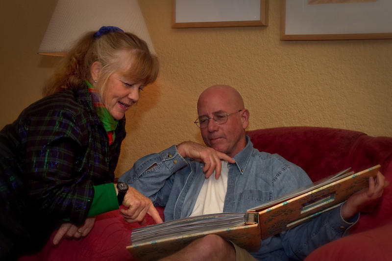 Christmas Day ~ Geri Lu and Patrick browsing through Rita's scrapbook