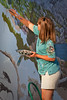 July 13, 2010 ~ Murals in Exeter<br /> Jana Botkin is the artist who is working on the newest mural going up on the walls of Exeter.  Jana grew up in rural Tulare County surrounded by orange groves with a daily view of the Sierra Nevada Mountains and has a reverance for the area.  I took this picture of her this morning while she was working on her 9th day of painting.  She was also being interviewed by one of our local TV stations at the same time. Exeter is a very fun town to live in, there is always something going on and the murals are one of my favorite attractions.