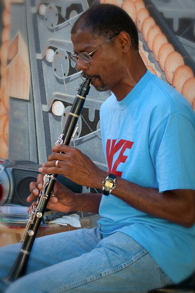 July 9th, 2010 ~ Jazz at the Wildflower<br /> Raymond Pitts a local artist played his clarinet at the Wildflower Cafe this evening.  It was cool, smooth Jazz which made for a nice relaxing evening.  (I almost forgot it was still 96 at 7:30 pm)  Raymond is sitting in front of one of our first murals in Exeter which made a great backdrop for his performance. <br /> I used my 350EX flash for the first time in a long time and I think it helped fill in the shadows.