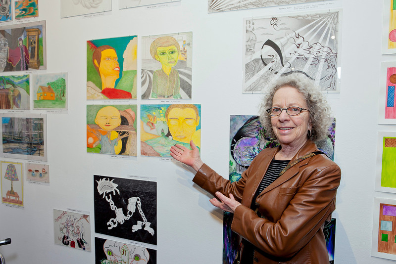 CPA Prison Arts Program instructor Phyllis Kornfeld with the work of her student Robert McKay.