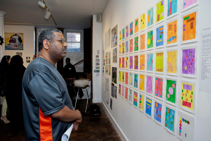 CPA's Tony McLendon viewing the work of Brian Schlicher at the opening reception.