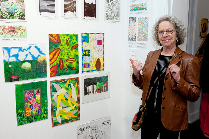 CPA Prison Arts Program instructor Phyllis Kornfeld with the work of her student Larry White.