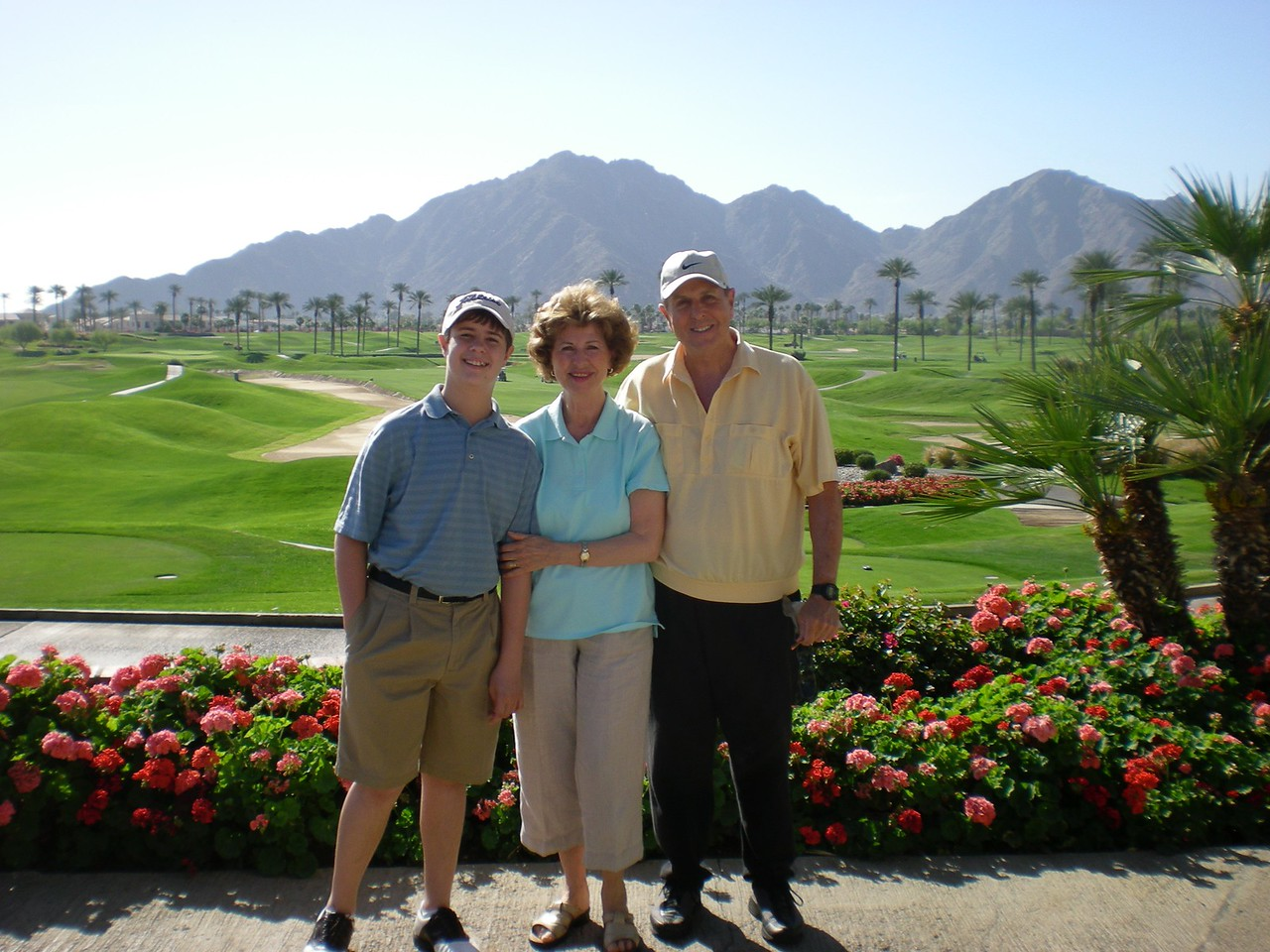 Tom, Paul and Betty over looking the fairway at La Quinta