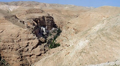 Monistary tucked away into the hillside next to an oasis NW of the Dead Sea, Israel.