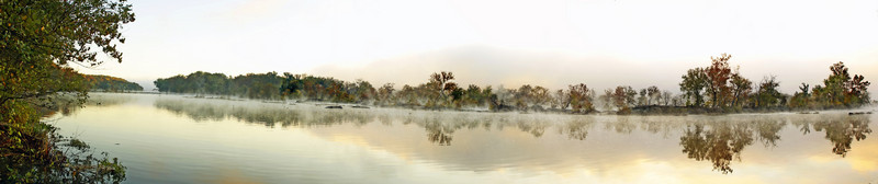 A PANORAMIC VIEW OF A FOGGY AND MISTY MORNING ON THE POTOMAC RIVER IN GREAT FALLS PARK IN GREAT FALLS VA.