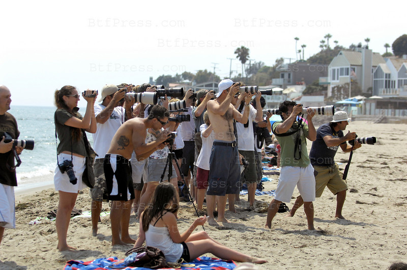 Paparazzi on the beach in Malibu,the target was Paris Hilton.