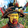 Huli Tribe warrior in his village. They are usually short and muscular, with a strong and proud personality