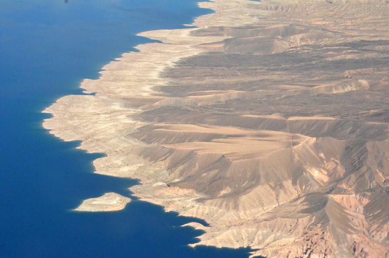 Lake shore encounters desert hills near Las Vegas Nevada.