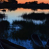 Sunset Over Okavango With Mokoros