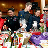 Checking out the items for the raffle at 10th annual Mary Kuczek/SunSanta Party are local kids L-R, Colin Heartqusit,8, Anthony Grace,14, Tyler Corrow,15, Lilly Heartqusit, 12 and Chloe Corrow,12. SUN/David H. Brow