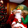 "Giving ""Santa"" a kiss is L-R, Frances Siara and Paula Stupakewicz, at the 10th annual Mary Kuczek/ SunSanta Party at the Dom Polski Club in Lowell. SUN/David H. Brow"