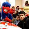 "At 10th annual Mary Kuczek/SunSanta Party is L-R, ""Rowdy"" the Riverhawk, Joseph Ruiz,2, and Calvin Bettencourt,13. SUN/David H. Brow"