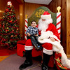 "Little Joseph Ruiz, 2, meets ""Santa"" (played by Tom Stupakewicz), at the 10th annual Mary Kuczek/ SunSanta Party at the Dom Polski Club in Lowell. SUN/David H. Brow"
