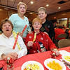 Armed with their raffle tickets are friends L-R, front, Viola Dodson of Billerica, Sandy Long of Lowell, in back is Rita Bencivenga of Lowell and Bea Roy of Lowell, at the Mary Kuczek/SunSanta Party. SUN/David H. Brow
