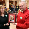 Two of the organizers of the 10th annual Mary Kuczek/SunSanta Party, Tricia Indelicato and Dave Desmarais hold a picture of the late Ed Madden, SUN employee and former SunSanta Fund Director, they held the party in his honor this year. SUN/David H. Brow