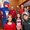 "Organizers and volunteers for the 10th annual Mary Kuczek/SunSanta Party held at the Dom Polski Club, L-R front, Ava Bettencourt 12, Alana Bettencourt 7, Calvin Bettencourt 13, back row: Peter Goyette, ""Rowdy"" the Riverhawk, Bob Jaracz, Dave Desmarais, Christine Thomas, Tricia Indelicato, and Joe Kazalski. SUN/David H. Brow"