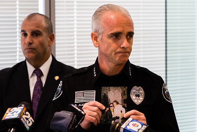 Boca Raton Police Chief Daniel C. Alexander holds a photo of Nancy and Joey Bochicchio at a press conference to update the case at the Grogan and Dove Federal Building in Miramar, FL. on September 29, 2015. (Joseph Forzano / The Palm Beach Post)