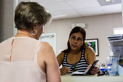 Diane Williams talks to Elgy Bello of Jupiter, FL in MyClinic on Indiantown Road in Jupiter, FL. MyClinic  provides primary health care to adults and serves low-income residents. (Joseph Forzano / The Palm Beach Post)
