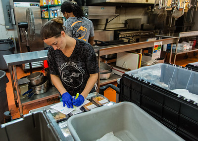 Kylissa Frederick checks food items off a list as she sorts through pre-packaged fresh meals to be delivered from Fuel Foods in West Palm Beach on Thursday, November 5, 2015. (Joseph Forzano / The Palm Beach Post)
