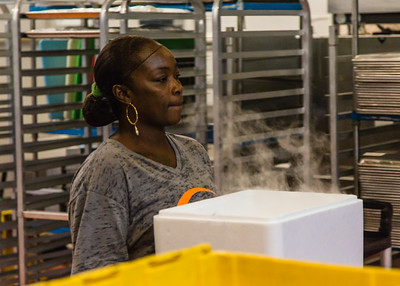 Nakia Wright carries a styrofoam cooler packed with freshly sealed food and dry ice at Fuel Foods in West Palm Beach on Thursday, November 5, 2015. (Joseph Forzano / The Palm Beach Post)