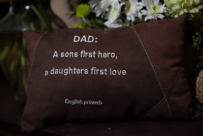A pillow with the quote 'Dad: A sons first hero, a daughters first love.' was given to Ari Arezoumandifar as a gift by his children. Arezoumandifar was shot and killed at the Liquor Market in Boynton Beach on November 22, 2015.
