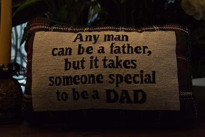 A pillow with the quote 'Any man can be a father, but it takes someone special to be a Dad' was given to Ari Arezoumandifar as a gif by his children. Arezoumandifar was shot and killed at the Liquor Market in Boynton Beach on November 22, 2015.