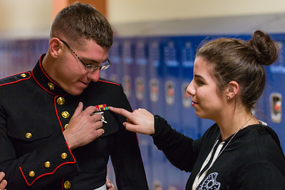 Marine Corporal William Tyler Christian and his sister, Amandalyn Christian are reunited at Palm Beach Gardens High School on Tuesday, March 15, 2016. Major Christian surprised his sister during her NJROTC class Palm Beach Gardens High School after being stationed in Yuma, Arizona for two years. (Joseph Forzano / The Palm Beach Post)