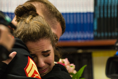 Amandalyn Christian hugs her brother, Marine Corporal William Tyler Christian, after he  surprised her during her NJROTC class at Palm Beach Gardens High School on Tuesday, March 15, 2016.  Corporal Christian returned home after two years stationed in Yuma, Arizona. (Joseph Forzano / The Palm Beach Post)