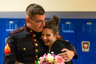 Amandalyn Christian smiles and hugs her brother, Marine Corporal William Tyler Christian, after he  surprised her during her NJROTC class at Palm Beach Gardens High School on Tuesday, March 15, 2016.  Corporal Christian returned home after two years stationed in Yuma, Arizona. (Joseph Forzano / The Palm Beach Post)