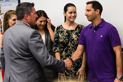 Palm Beach County Schools Superintendent Dr. Robert Avossa shakes hands with Stehpen Anand, Palm Beach County School Teacher of the Year at Dreyfoos School of the Arts on Tuesday, March 15, 2016.  Dreyfoos Principal Dr. Susan Atherley, Palm Beach County School Board Member Erica Whitfield and Anand's wife, Lalena look on.  (Joseph Forzano / The Palm Beach Post)