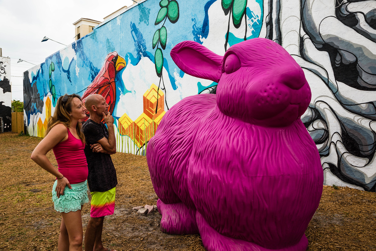 Maxine Christine Carperner and John Cruz of West Palm Beach admire the easter bunny art installation display on Clematis Street across from O'Shea's Pub on Friday, March 25, 2016. (Joseph Forzano / The Palm Beach Post)
